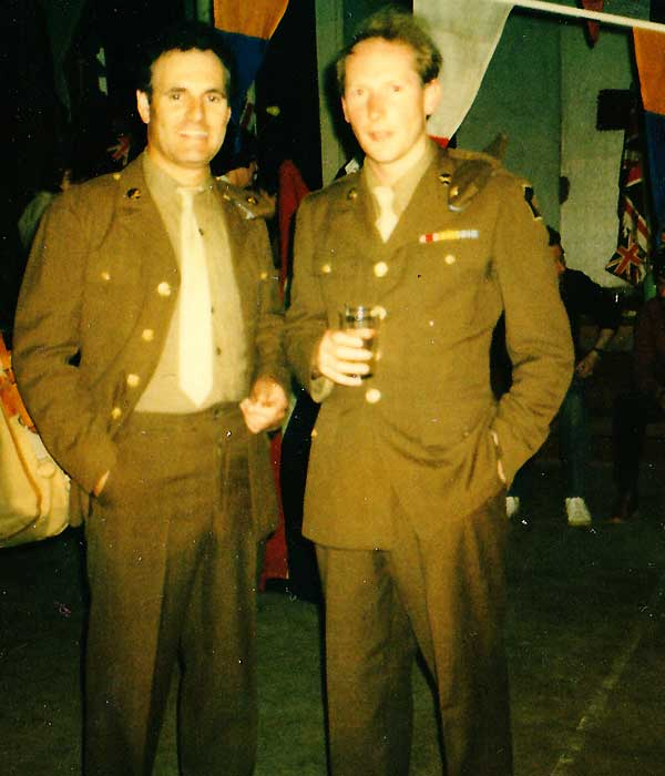 sean glenn acting in how we use to live dressed in full sixties issue faen coloured army clothing with one hand in his left trouser pocket